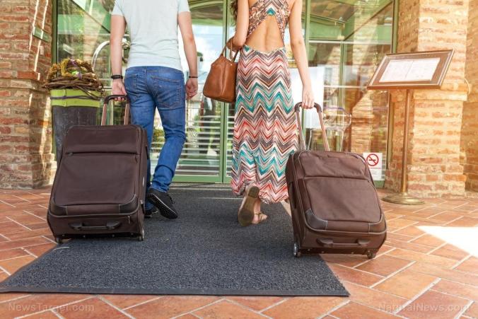 Couple-Vacation-Travel-Hotel-Luggage.jpg